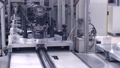 Automated Machine. Robotic Equipment. Commercial mass production at Automatic Conveyor Belt of Factory Line. 75797190