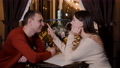 Cheerful young couple sitting together and looking at each other during romantic meeting 75838699