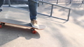 Asian woman skateboarder skateboarding at skatepark 75854262