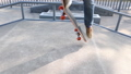 Asian woman skateboarder skateboarding at skatepark 75854263