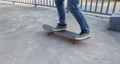 Asian woman skateboarder skateboarding at skatepark 75854266