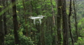 White drone with camera flying in tropical forest, with sound 75854698