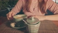 Close up of young lady with happy smile drinking coffee in cafeteria tilt up shot 75877305