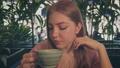 Nice lady at cafe drinking coffee closeup tilting shot 75877307