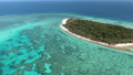 Aerial: Several approaches of Lady Musgrave in the Southern section of the Great Barrier Reef, Australia. An untouched tropical island with no building or resorts. 75911813