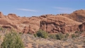 Red Orange Monolithic Rocks Formation In Arches Park On Sunny Day In Motion 75921982
