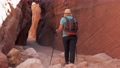 Hiker Hiking In Mountains And Gorge Enters Cave Canyon With Red Rocks 75931309
