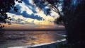 Looped animation of a red sunset in a warm tropical country. The sea splashes seductively, and the sun disappeared over the horizon. The animation is for nature, summer or travel backgrounds. 75937857