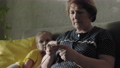 Grandmother Knitting With Child 75973579