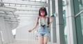 Asian female traveler walking 76039142