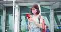 Asian traveler use smartphone 76039145