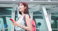 Asian traveler use smartphone 76039146