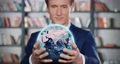 The Whole World is in Your Hands. Businessman Holding Planet Earth in His Hands. Beautiful 3d Animation of Abstract Spinning Earth in Human Arms. Global Business Concept. FullHD Full HD 4096x2160. 76055292