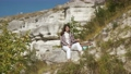 Young woman relaxing on hill during hiking at Bakota area 76084387