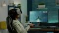 Black woman gamer playing video game at powerful computer using VR 76089454