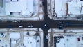 Top down aerial overhead perspective of street. Drone view of car traffic on road passing through small town at winter evening, 76094140