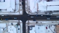 Top down aerial overhead perspective of street. Drone view of car traffic on road passing through small town at winter evening, 76094152
