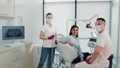 Portrait of successful dentists. Dentist assistant and patient in the dentist's office. Smiling satisfied patient together with dentists. Portrait of successful doctors. 76109331