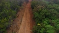 Aerial view of mountain slopes covered with red clay soil and green vegetation. Canary Islands, Spain 76127524