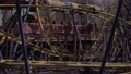 An abandoned, rust-covered roller coaster ride in an abandoned amusement park. 76147456
