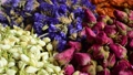 Flower teas on a wooden board. Jasmine flowers, Dianthus, Myosotis, lily petals, tea and French rose. 76156299