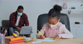 Father and daughter wear medical face masks at home, girl draws while dad works on laptop, afro american man teacher surfs net, kid does homework points finger to ball on table talking, lockdown 76161731