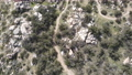 Aerial view of mountain bikers in small trails in the mountain, California 76165244