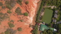 Aerial slowmotion shot of a red canyon or Fairy stream at the border of desert in the Mui Ne village in southern Vietnam 76203392