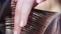 Hairdresser cuts the hair of a woman 76226816