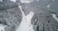 Ski resort with lift, slope aerial. Winter nobody nature landscape. Spruce forest at mountain hills 76227408