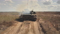 Tank army train aerial. Military machine fire power demonstration at desert field. National defense 76227427