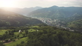 Mountain town in sun green valley aerial. Nobody nature landscape. Cottages at sunny mounts forest 76227428