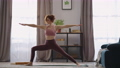 sportswoman is performing yoga asana at home, training alone in living room at morning, keeping fit 76229779