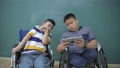 Education concept of 4k Resolution. Children with disabilities play games with a tablet. 76233917