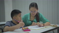 Education concept of 4k Resolution. The teacher is teaching disabled children to draw and paint. 76233923