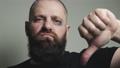 Bald battered man shows dislike 76261297