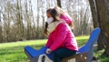Slow Motion of Little Girl in Mask on the Playground playing in rocking dolphin 76268399