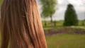 Hair of a young girl at sunset in the park. 76268418