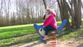 Little Girl in Medical Mask on the Playground playing in rocking dolphin 76269627