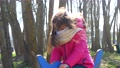 Close up of Girl in Medical Mask on the Playground playing in rocking dolphin 76269631