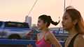 Healthy female friends jogging 76287850