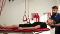 Professional senior physiotherapist doing manual treatment to a men s thoracic 76290664
