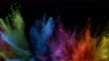 Super slow motion of coloured powder explosion isolated on black background. 76292353