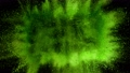 Super slow motion of coloured powder explosion isolated on black background. 76292355