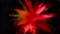 Super slow motion of coloured powder explosion isolated on black background. 76292356