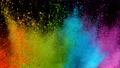 Super slow motion of coloured powder explosion isolated on black background. 76292362