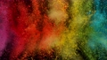 Super slow motion of coloured powder explosion isolated on black background. 76292364