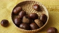 Fresh edible chestnuts in a basket 76298675