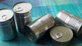 Tin cans with food. Conserved food. Closeup of a group of aluminium cans. 76298676
