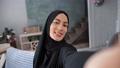Closeup face Muslim woman face posing photographing at home interior POV shot. 4k Dragon RED camera 76301121